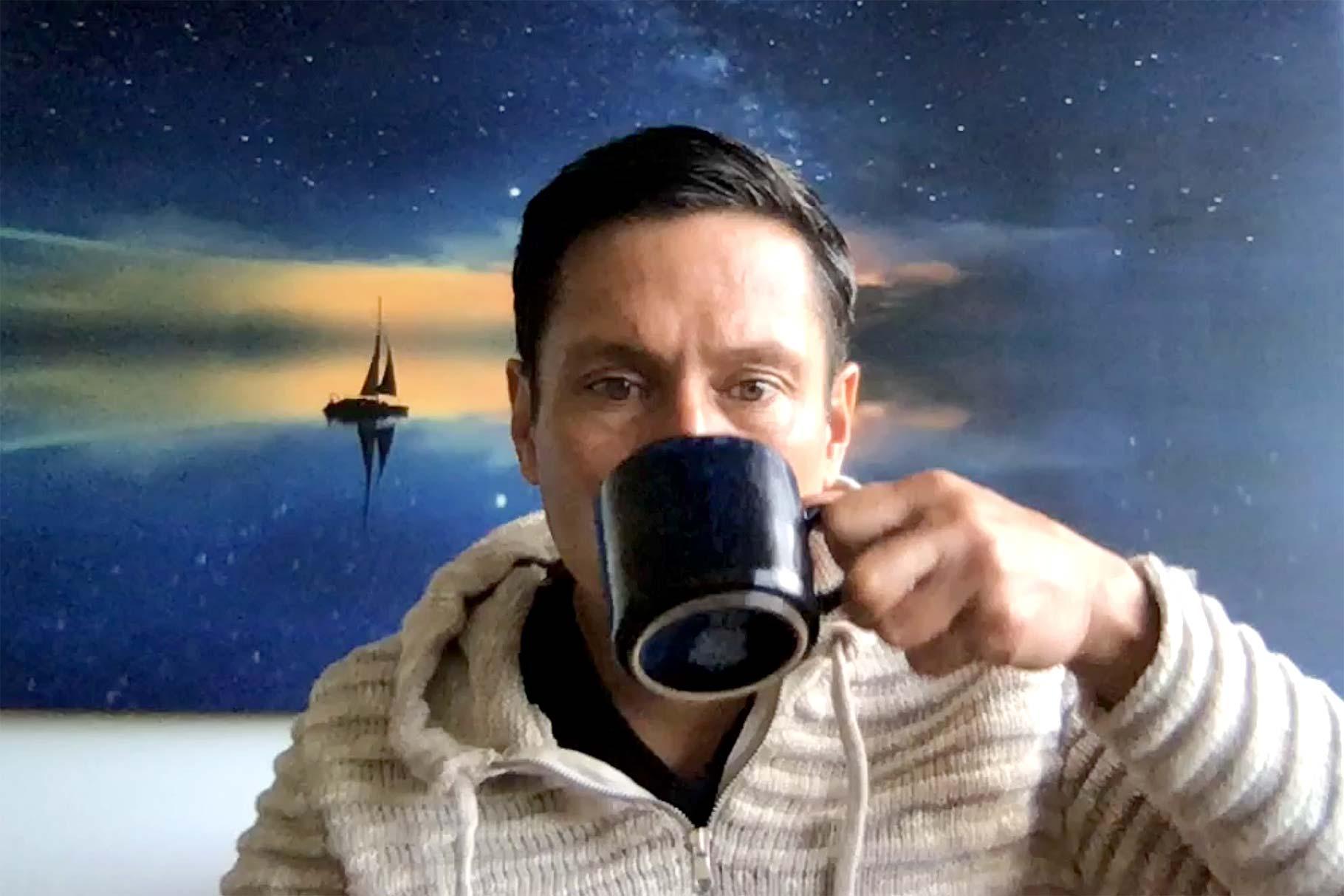 kenn sips on coffee